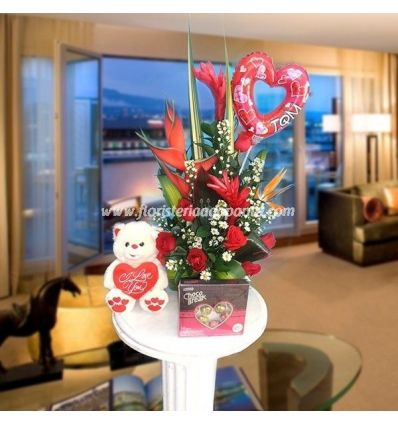 Arrangement of roses and teddy.