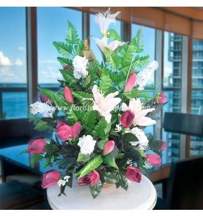 Artificial roses and lilies